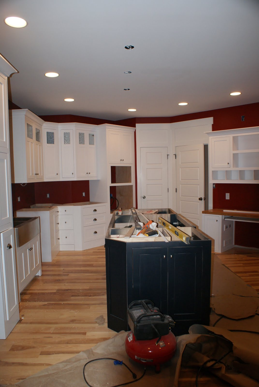 Kitchen Island and most of the cabinets as well as pantry door and