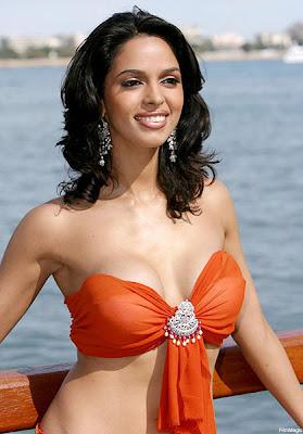 Mallika Sherawat posing for clicks