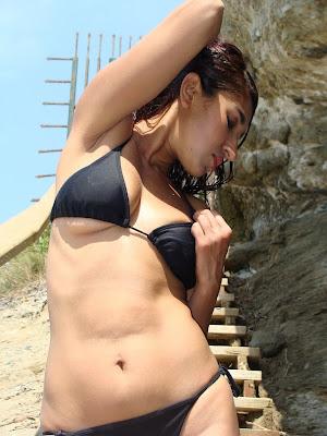Model in black bikini