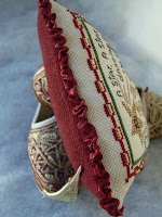 Close up of ruched ribbon edging
