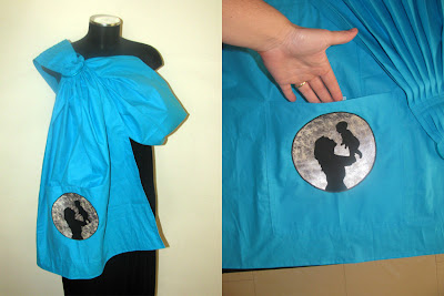 Σιδερότυπο πάνω σε απλικαρισμένο ύφασμα στην τσέπη αυτού του μάρσιπου αγκαλιάς sling