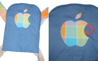 Η τσέπη σ' αυτό το mei tai είναι εμπνευσμένη απ' το μηλαράκι της Apple, και φτιάχτηκε για γονείς που είναι οπαδοί των υπολογιστών Macintosh! Το άνοιγμα της τσέπης είναι το δάγκωμα στο μήλο!