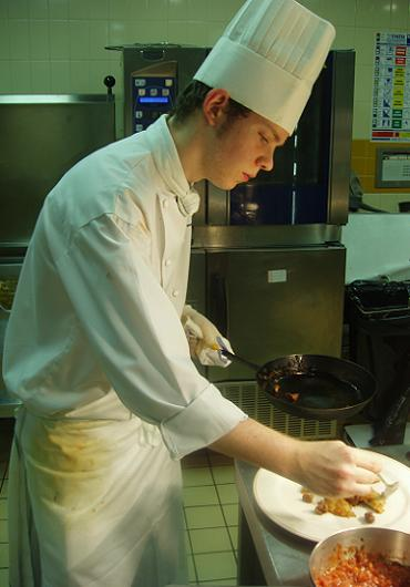 Me, plating up at the Escoffier Room's tiny pass
