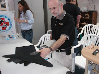 Kevin Carroll of Hanger Prosthetics demonstrates new artificial dolphin tail during Friday's press conference in Florida. Photo, H Weikle