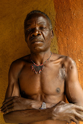 Reformed poacher Thomson Tembo, Zambia, proudly models a necklace made from snare wire.Photo: Julie Larsen Maher (WCS)