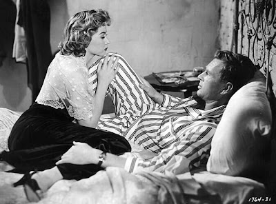 Gloria Grahame closes in on Sterling Hayden in 1954's Naked Alibi.