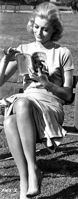 Constance Towers reads some pulp fiction in the sun.