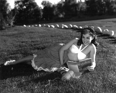 Paulette Goddard expands her mind by reading.