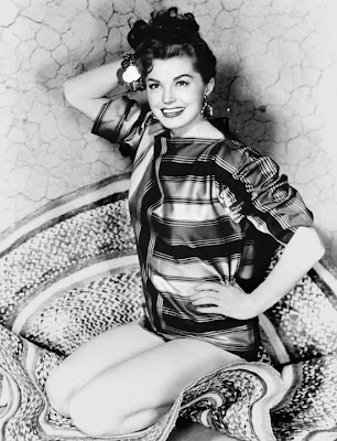 There are many, many really bad pictures of Esther Williams with bad 50s hair. This is one of the good ones.