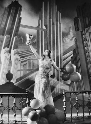 Nancy Carroll with a great art deco backdrop.