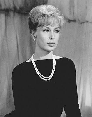 Barbara Eden. Pearls on basic black.
