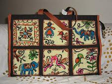 Pasta e tecidos indianos bordados