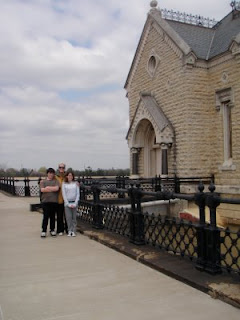 water company gothic revival stone pump house with two people standing out front