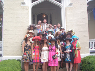 all the men and women at our derby dressed in hats and finery and ready to head to the track. beautiful dresses