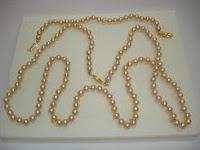 Collar de perlas en plata y joyas