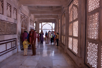 People walking in the corridor around the central tomb in Fatepur Sikri