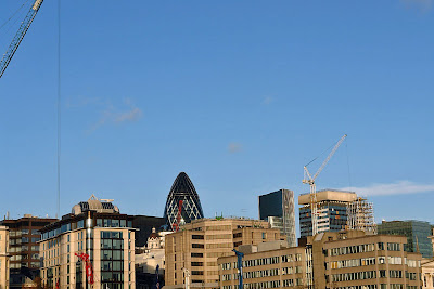 A view of the London skyline with the top of the Gherkin (Swiss Re building) in the background