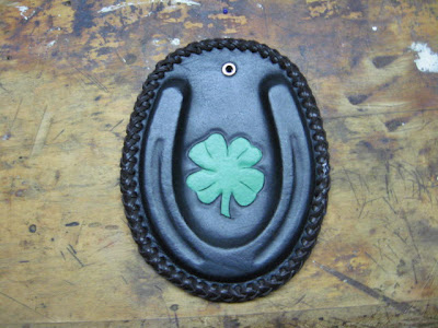 Paperweight or Plaque, wet molded/shaped leather with a four leaf clover