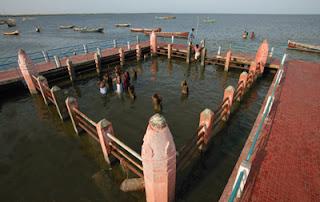 Devipattinam Navagraha stones in water