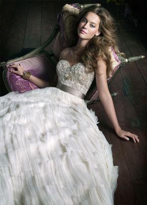 These handbeaded wedding dresses with jewel encrusted bodices and lavish