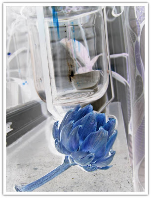 Inverterad bild, kronärtskocka i glasmojängen