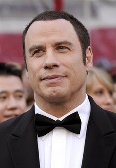 Bahamas holds 2 in alleged plot to extort Travolta