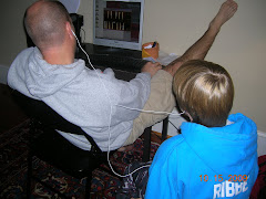 Jacob sharing his newly downloaded tunes with his dad!