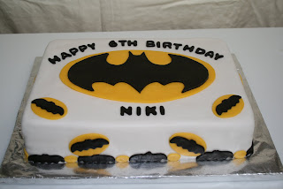 DeShays Desserts Brown and pink birthday cake batman cake Doctor