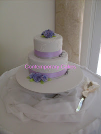 Lilac sugar roses stacked cake.