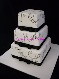 Bride and grooms name signature cake.