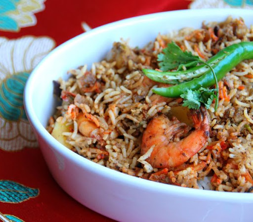 The flavor of mint sprigs and coconut milk is highly echoed in this prawn biryani recipe - what a delectable combination ..