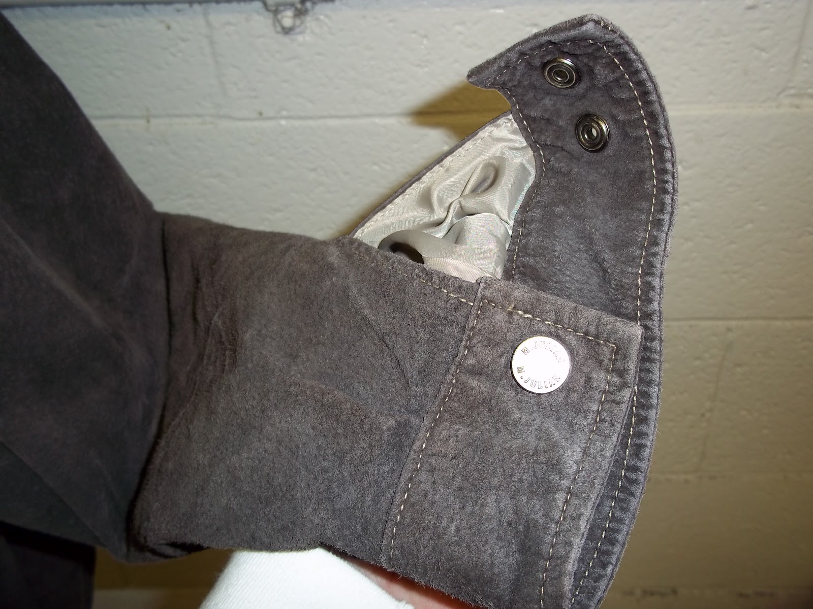 Leather jacket damage - If Properly Treated After Cleaning The Leather Would Have Been Redyed And The Oils Put Back Water Repellent Can Also Be Applied To The Suede To Protect It