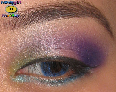 blue and purple makeup. green, and lue makeup to