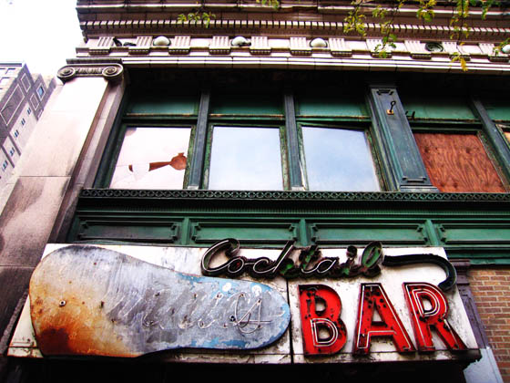 An abandoned cocktail bar in Detroit, Michigan with a great neon sign.
