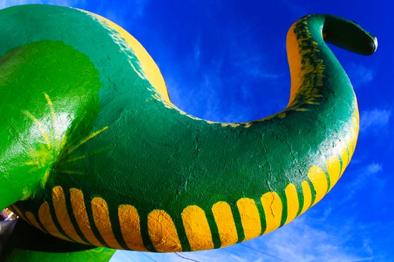The Route 66 big green dinosaur in Holbrook, Arizona is a must see attraction on the Mother Road.