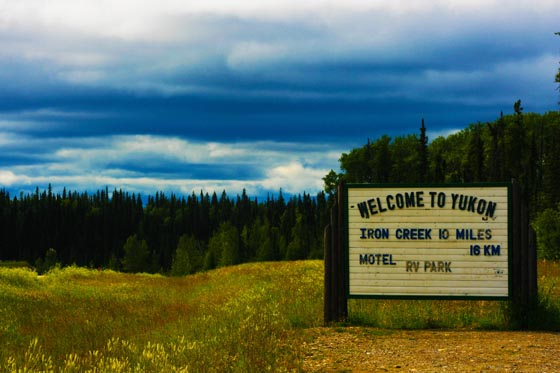 The 'Welcome to Yukon' sign traveling into the Yukon Territory on the Alaska Highway.