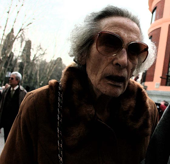 An elderly woman in Madrid wearing really big sunglasses.