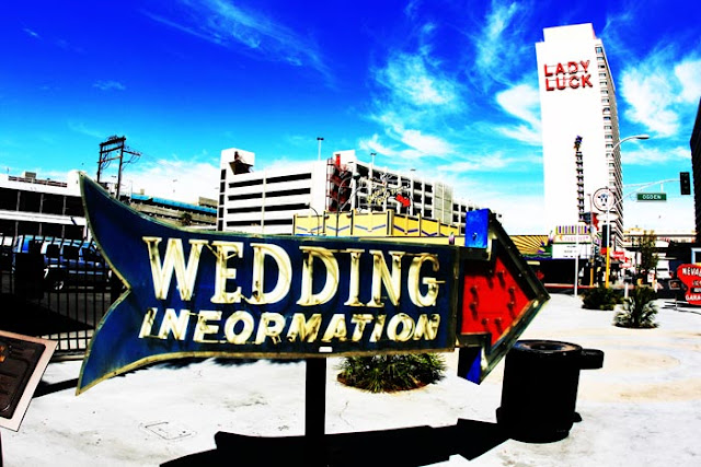 "A vintage neon sign on Fremont Street in Las Vegas that says,""Las Vegas Wedding Information""."