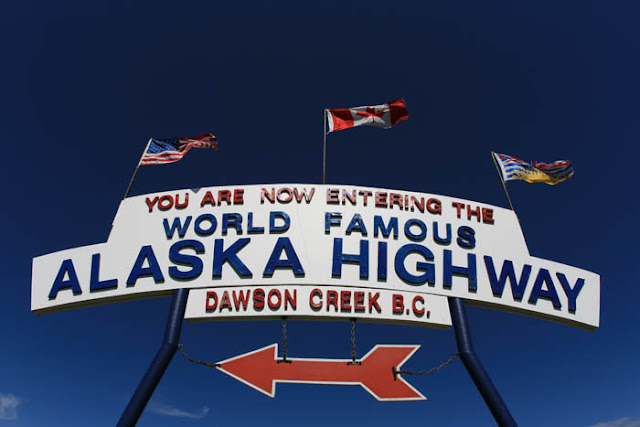 The 'You Are Now Entering The World Famous Alaska Highway' sign in Dawson Creek, British Columbia.