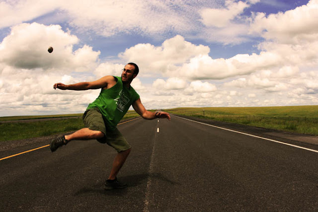 Kicking a hacky sack in the middle of the highway in Fort Pierre National Grasslands in South Dakota.
