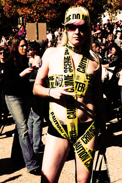 A girl wearing crime scene tape as a costume on Halloween in Washington D.C.