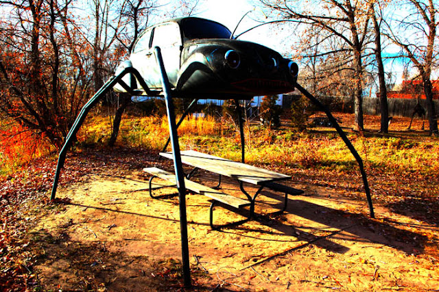A Volkswagen Beetle made into a giant bug sculpture at the Swetsville Zoo in Fort Collins, Colorado.