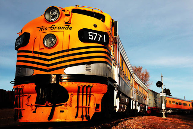 A big, yellow, Rio Grande train engine at the Colorado Railroad Museum.