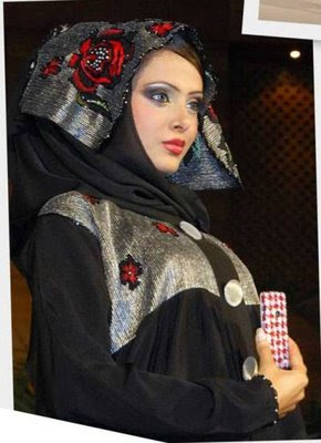 woman wearing a silver and red abaya