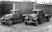 Two 2-ton Morris lorries standing in the brewery yard c1938.