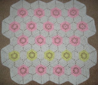 hexagon baby blanket, in pink with yellow accents