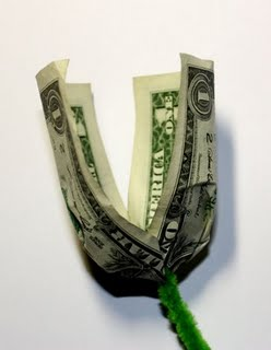 Origami money flowers how to make money origami flower rose step2 image adding wire between origami rose mightylinksfo