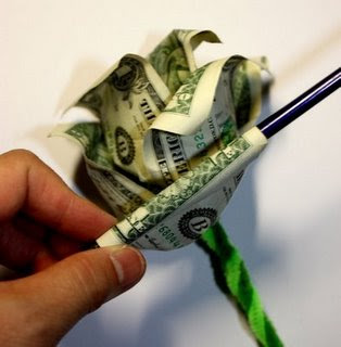 step 5 image - curling the money origami rose