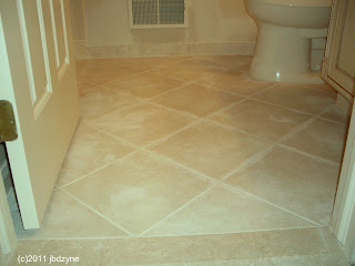 new ceramic tile bathroom floor in diagonal 12 by 12's