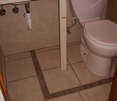 small powder room, fancy tile